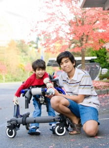 Teen boy with disabled little brother